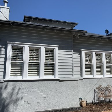 White & Grey Weatherboard Home