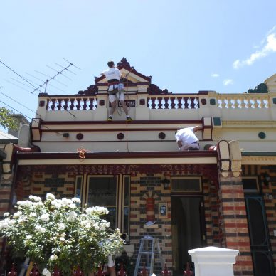 Harness Painters Painting a House