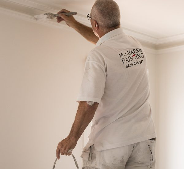Image of our painter painting a bedroom